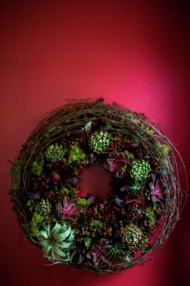 a living succulent wreath, created by H-E-B's new Blooms Design Studio, could ADd an element of surprise to your holiday DÉcor. Photo: Dylan Aguilar