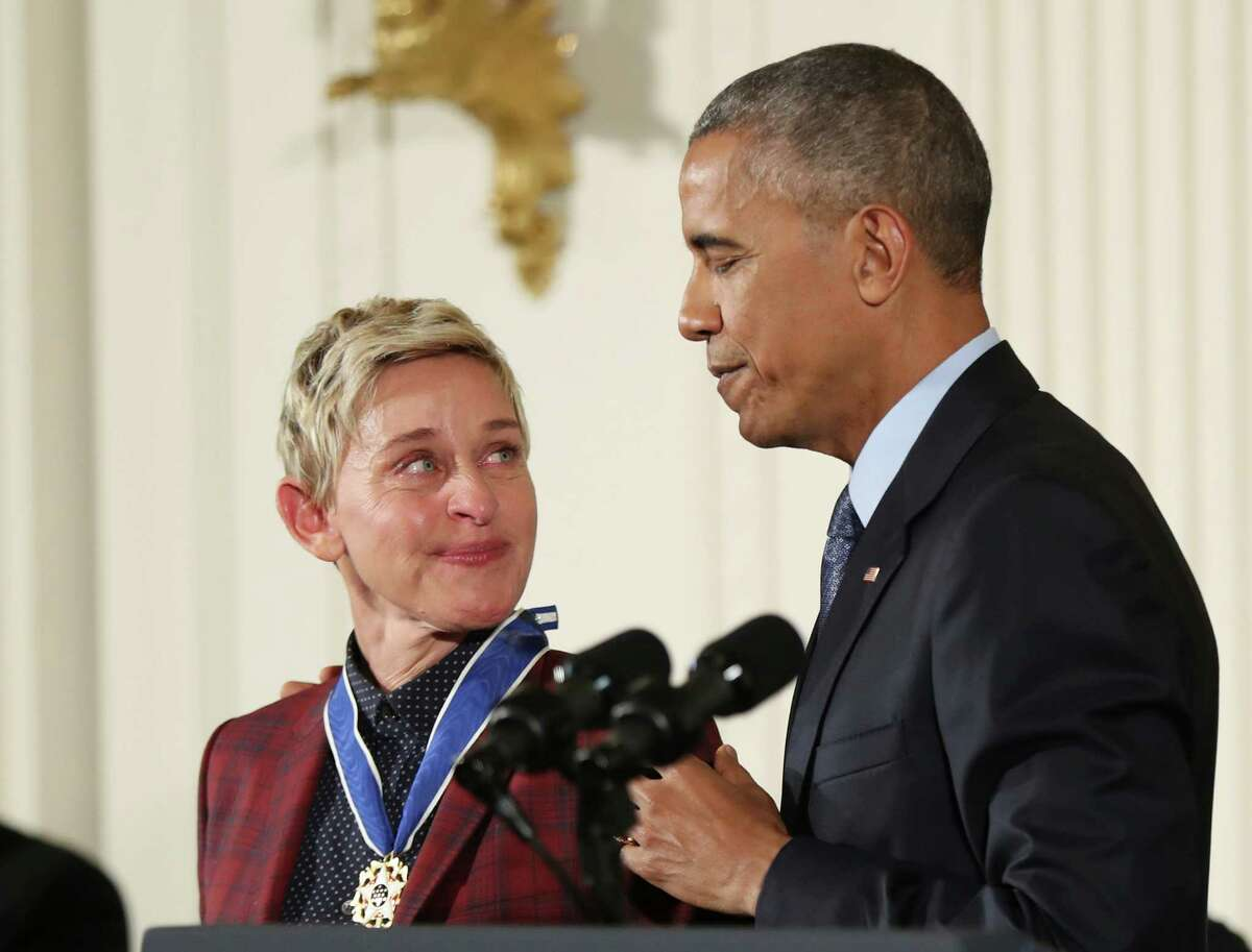 Actress, comedian, and talk show host Ellen DeGeneres, glances at President Barack Obama as she is presented the Presidential Medal of Freedom during a ceremony in the East Room of the White House Tuesday, Nov. 22, 2016, in Washington. Obama is recognizing 21 Americans with the nation's highest civilian award, including giants of the entertainment industry, sports legends, activists and innovators.