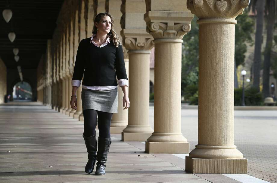 Staci Lewis, a doctoral student in environment and resources, walks through the Main Quad to her lab in Stanford. Photo: Paul Chinn, The Chronicle