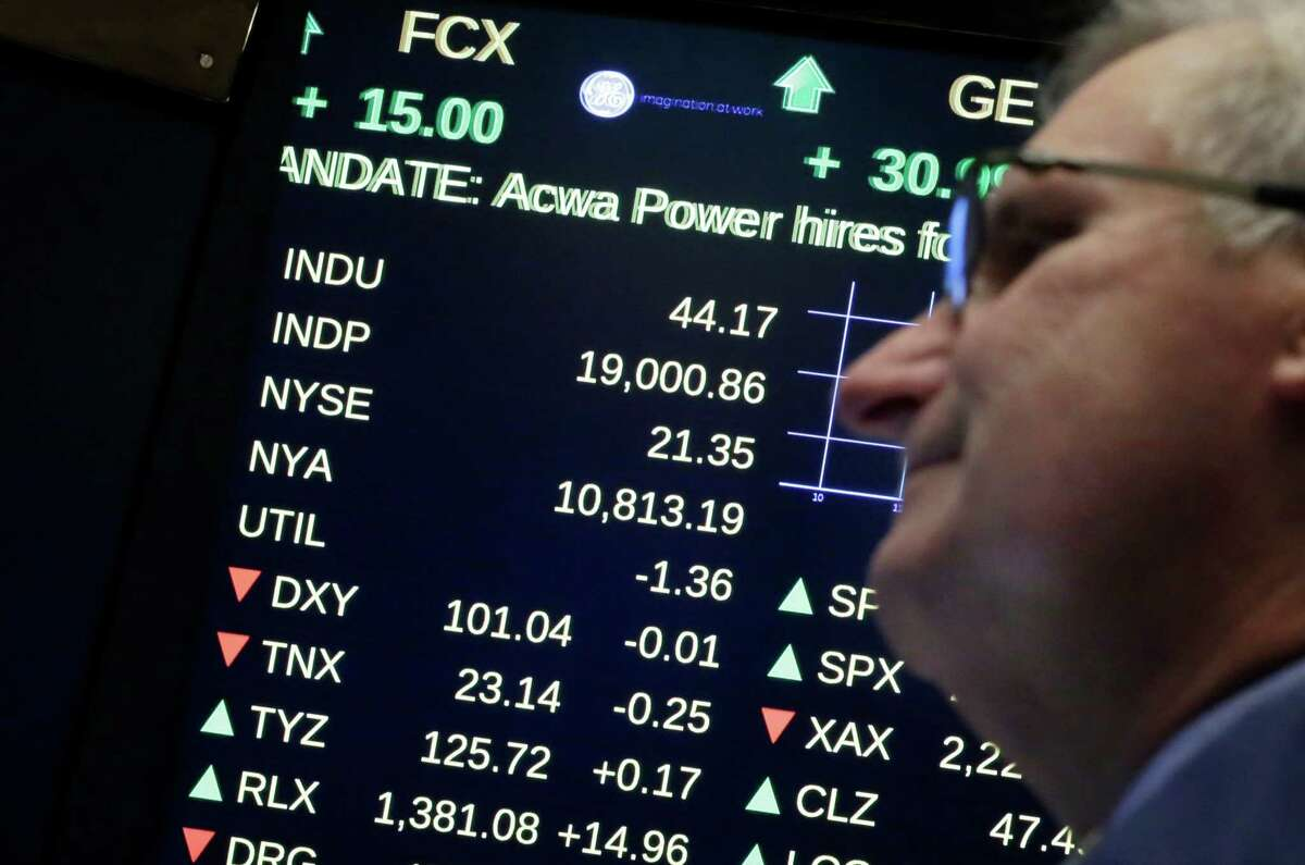 A board above the trading floor of the New York Stock Exchange shows the Dow Jones industrial average above 19,000, Tuesday, Nov. 22, 2016. U.S. stocks are rising Tuesday morning after most major indexes closed at record highs the day before. (AP Photo/Richard Drew)