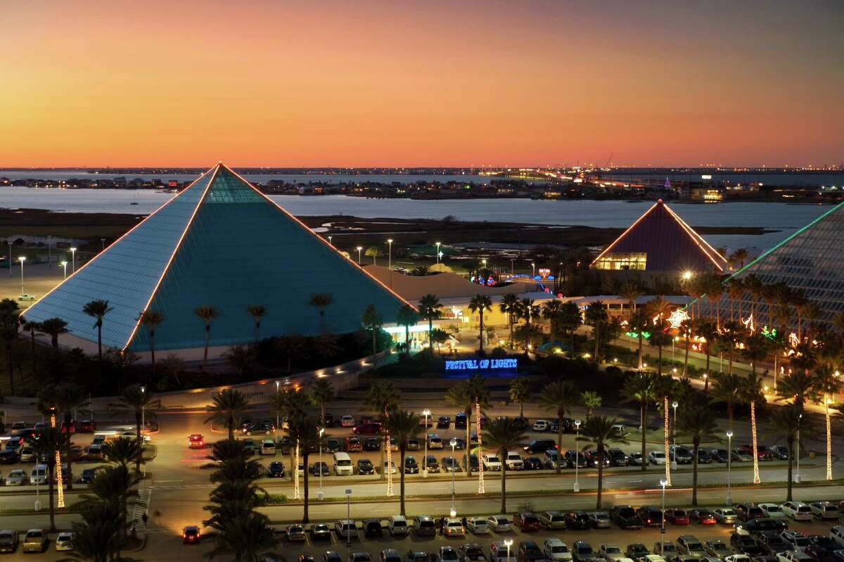 View of the three illuminated pyramids during the Festival of Lights at Moody Gardens in Galveston, Texas during the Christmas Season photographed at dusk from atop the Moody Gardens Hotel. The Festival of Lights includes a mile-long trail of more than a million lights.