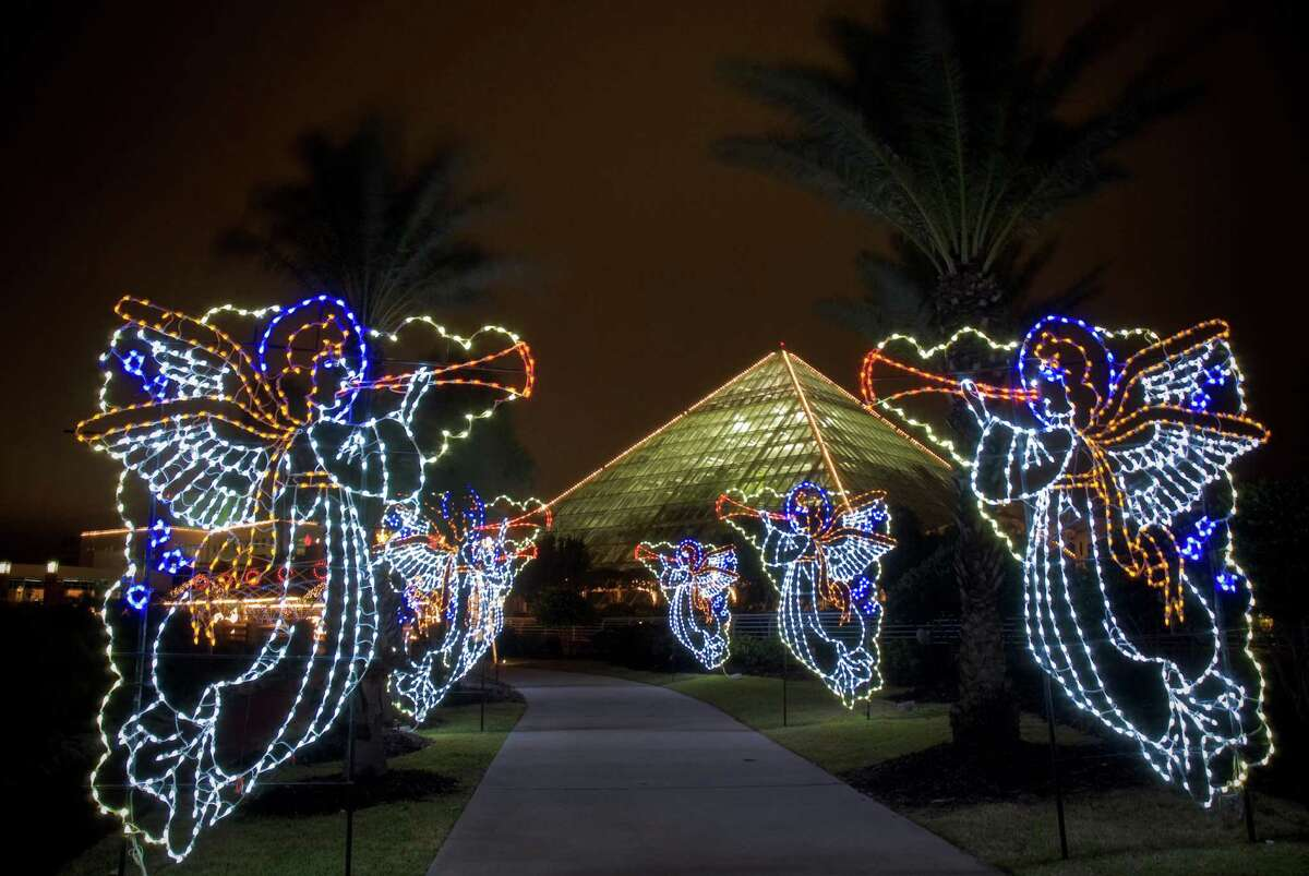 Angels light up the walkway leading to Moody Garden's Festival of Lights in Galveston.
