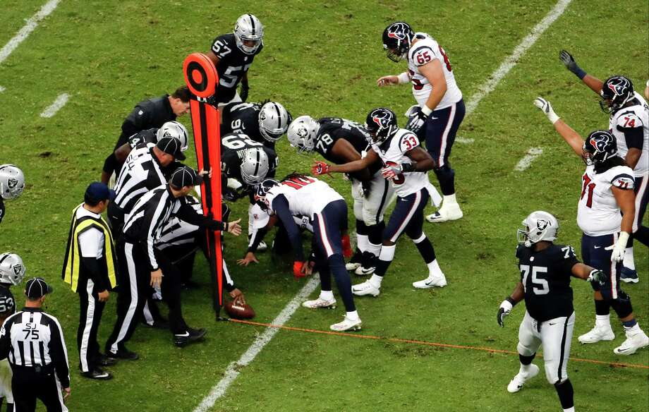 Referees measure as the Houston Texans fall short of getting a first down during the second half of an NFL football game against the Oakland Raiders Monday, Nov. 21, 2016, in Mexico City. (AP Photo/Dario Lopez-Mills) Photo: Dario Lopez-Mills, STF / Copyright 2016 The Associated Press. All rights reserved.