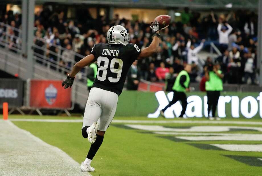 Oakland Raiders wide receiver Amari Cooper scores a touchdown during the second half of an NFL football game against the Houston Texans Monday, Nov. 21, 2016, in Mexico City. (AP Photo/Eduardo Verdugo) Photo: Eduardo Verdugo, STF / Copyright 2016 The Associated Press. All rights reserved.