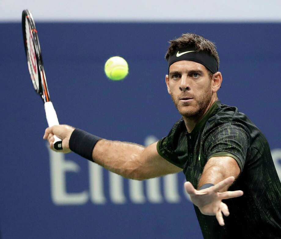 FILE - In this Sept. 7, 2016, file photo, Juan Martin del Potro, of Argentina, readies to hit a forehand return during his match against Stan Wawrinka, of Switzerland, during the quarterfinals of the U.S. Open tennis tournament, in New York. Led by Juan Martin del Potro, Argentina is bidding to end its long pursuit of the Davis Cup title when it faces Croatia in the final this weekend. (AP Photo/Seth Wenig, File) Photo: Seth Wenig, STF / Copyright 2016 The Associated Press. All rights reserved.