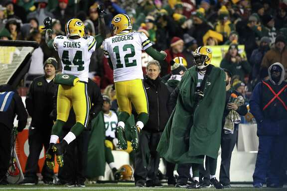 LANDOVER, MD - NOVEMBER 20: Running back James Starks #44 of the Green Bay Packers celebrates with teammate quarterback Aaron Rodgers #12 of the Green Bay Packers after scoring a fourth quarter touchdown against the Washington Redskins at FedExField on November 20, 2016 in Landover, Maryland.
