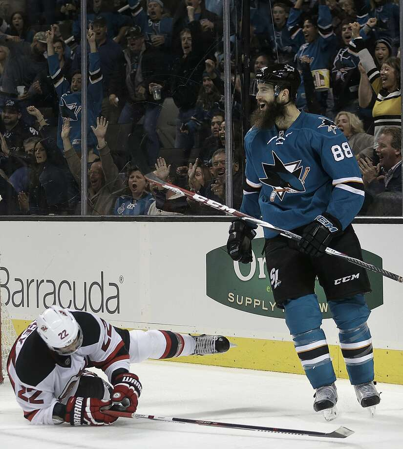 Brent Burns, right, celebrates after scoring a goal in Monday night's 4-0 defeat of New Jersey. Photo: Ben Margot, Associated Press
