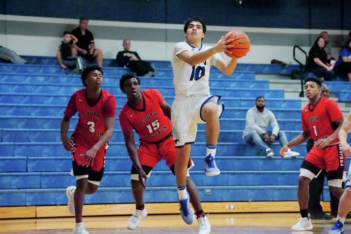 Friendswood's Alex Dehoyos drives to the basket in the Mustangs' 79-76 overtime win against South Houston Tuesday. Dehoyos scored 24 points.
