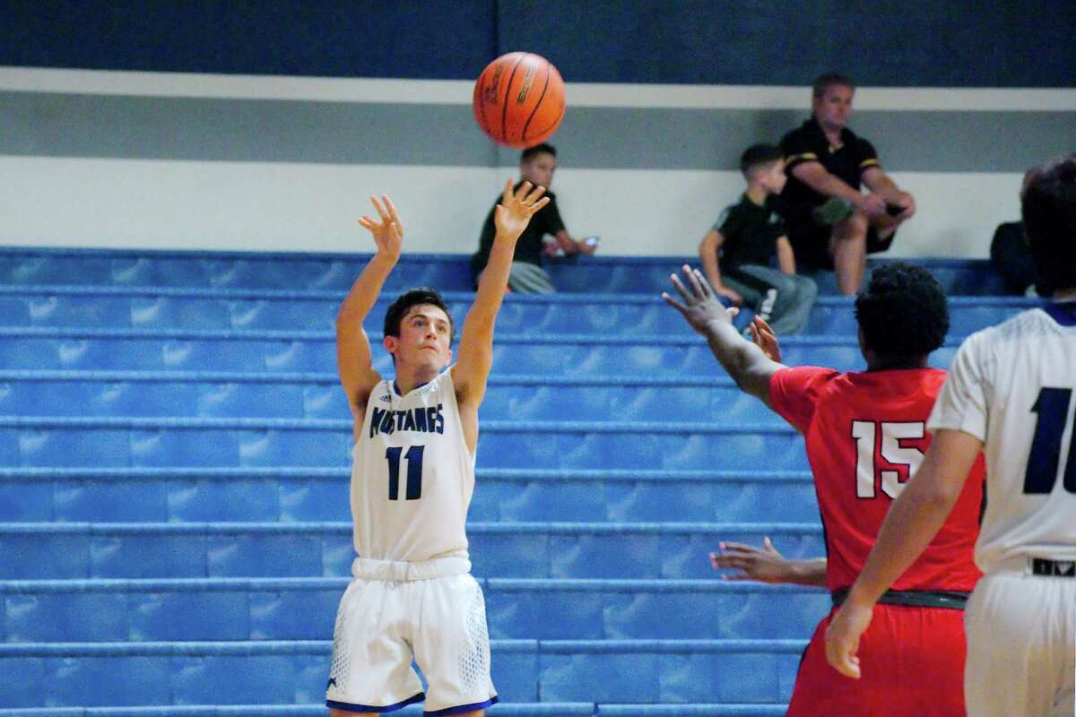Friendswood's Garrett McGregor launches a shot against South Houston Tuesday in a non-district boys' basketball game.