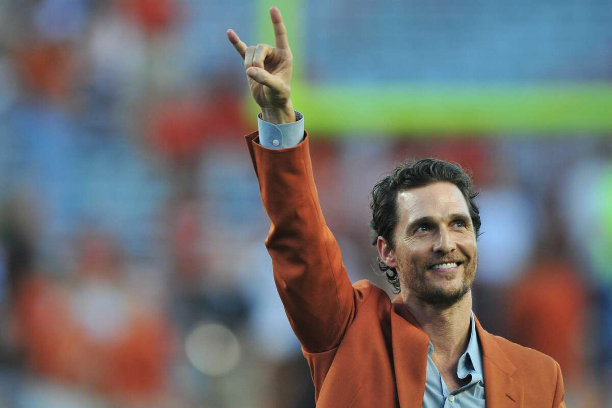 Matthew McConaughey throws his horns up before kickoff between the Texas Longhorns and Iowa State Cyclones on Oct. 18, 2014 at Darrell K Royal-Texas Memorial Stadium in Austin.
