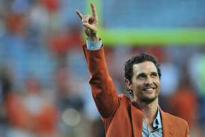 AUSTIN, TX - OCTOBER 18:  Matthew McConaughey puts his horns up before kickoff between the Texas Longhorns and Iowa State Cyclones on October 18, 2014 at Darrell K Royal-Texas Memorial Stadium in Austin, Texas.  (Photo by Cooper Neill/Getty Images)