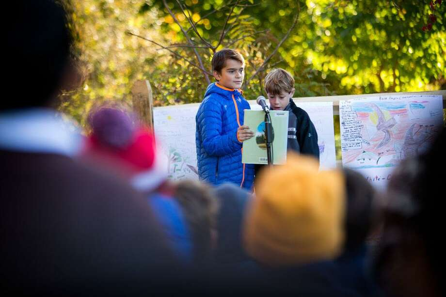 Brunswick School lower schoolers, left to right, Lundeen Cahilly and Teo Ocaña read a poem at the opening ceremony for the new schoolyard habitat and outdoor classroom. Brunswick is one of 17 schools that have teamed with Audubon Connecticut's Schoolyard Habitat Program. The program named eight new schools earlier this week, half of them in Fairfield County. Photo: Contributed / Contributed Photo / (c) 2015 Brunswick School Greenwich Time contributed