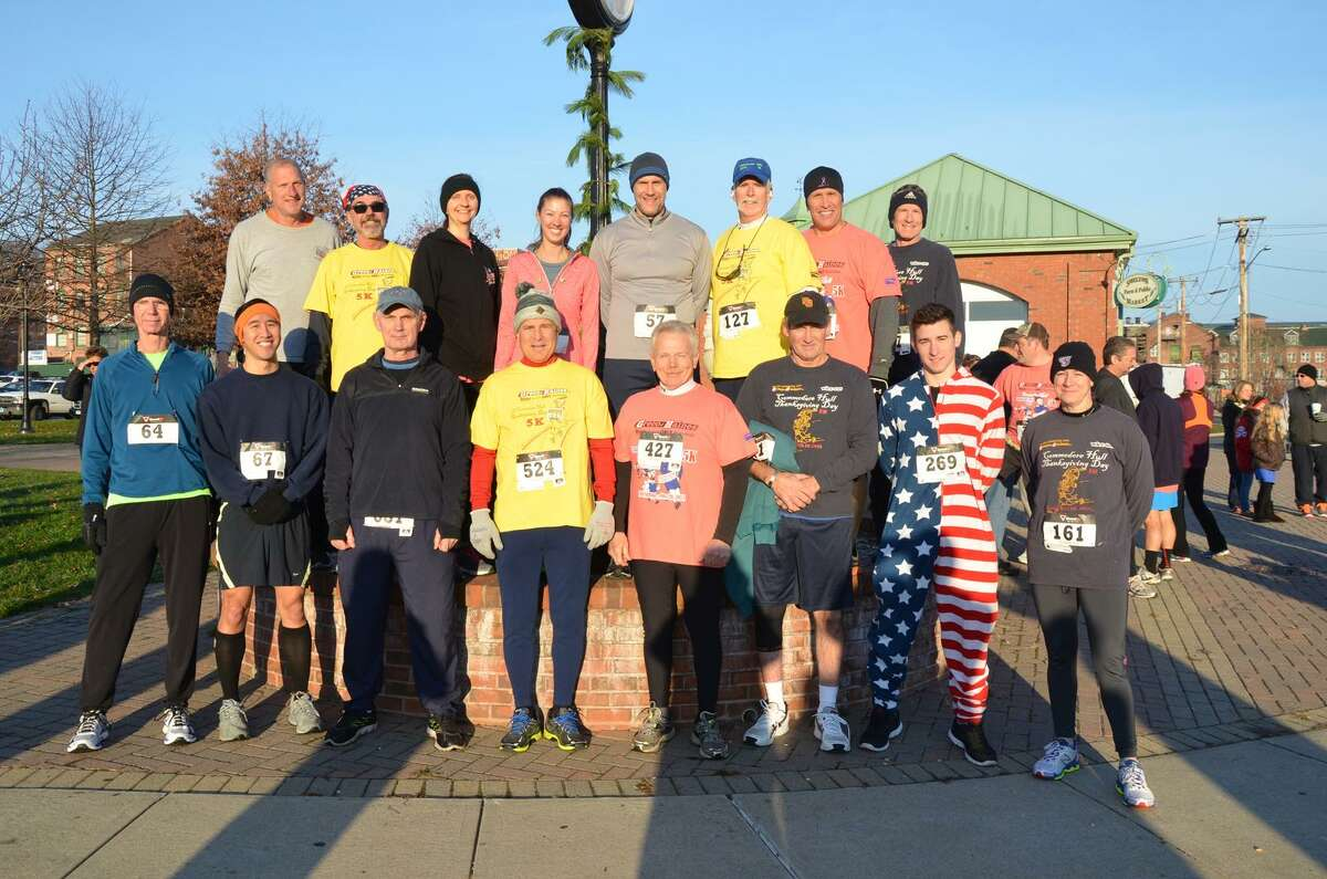 Shelton Mayor Mark Lauretti, top left, is joined by a group of runners before that start of last year?'s 5K Commodore Hull Turkey Day Road Race. The 15th annual running of the race through Shelton and Derby starts this Thanksgiving at 8 am.
