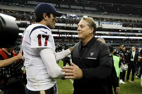 Houston Texans quarterback Brock Osweiler greets Oakland Raiders head coach Jack Del Rio after an NFL football game Monday, Nov. 21, 2016, in Mexico City. The Raiders won, 27-20. (AP Photo/Rebecca Blackwell)