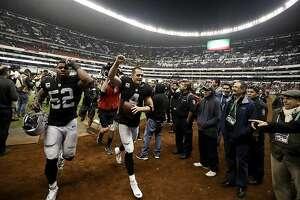 Oakland Raiders quarterback Derek Carr, center, and defensive end Khalil Mack (52) celebrate after their NFL football game against the Houston Texans Monday, Nov. 21, 2016, in Mexico City. The Raiders won, 27-20. (AP Photo/Eduardo Verdugo)