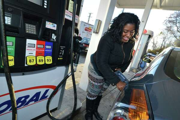 Stamford's Lettresha Nelson fills up at the Global gas station on Connecticut Ave. in Norwalk Conn. on Tuesday November 22, 2016. Area residents will travel near and far for the Thanksgiving holiday.