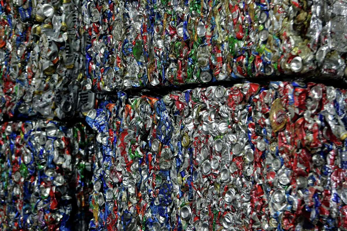 Pallets hold loads of crushed aluminum cans at South Post Oak Recycling Center, Tuesday, Nov. 22, 2016, in Houston.