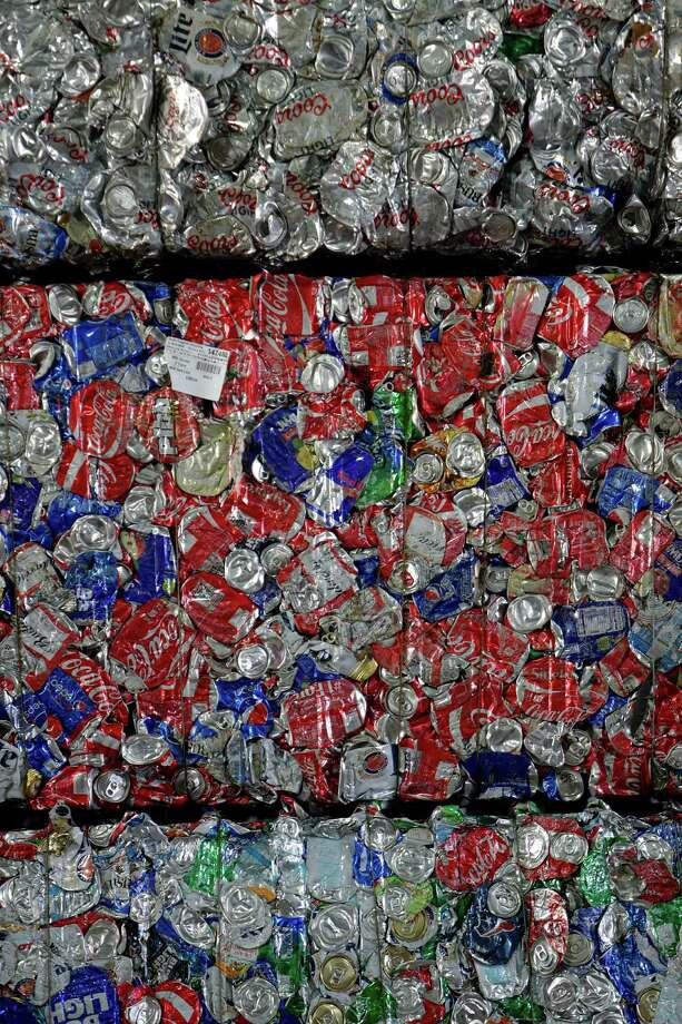 Pallets hold loads of crushed aluminum cans at South Post Oak Recycling Center, Tuesday, Nov. 22, 2016, in Houston. Photo: Houston Chronicle / © 2016 Houston Chronicle