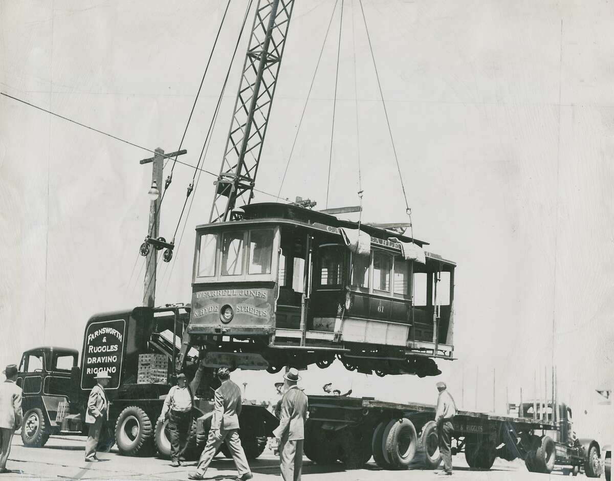 """Hollywood bound - A California Street cable car is hoisted aboard a truck for its first out-of-town visit. It will be used at authentic background in RKO's """"I Remember Mama,"""" the play adapted from Katherine Forbes' """"Mama's Bank Account,"""" which is all about San Francisco in the early days of the [20th] century. The car is 41 years old, well-fitted for the role. The studio said it could have made a cable car of its own, but wanted the real thing. The car will be returned here. Photo was taken June 12, 1947."""