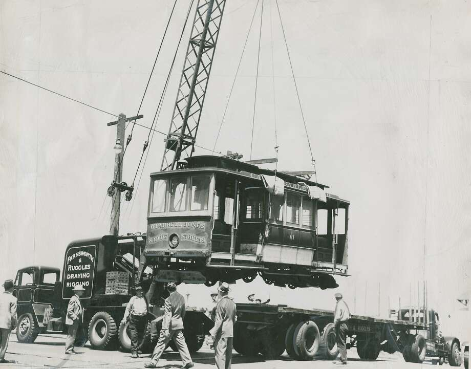 """Hollywood bound - A California Street cable car is hoisted aboard a truck for its first out-of-town visit. It will be used at authentic background in RKO's """"I Remember Mama,"""" the play adapted from Katherine Forbes' """"Mama's Bank Account,"""" which is all about San Francisco in the early days of the [20th] century. The car is 41 years old, well-fitted for the role. The studio said it could have made a cable car of its own, but wanted the real  thing. The car will be returned here. Photo was taken June 12, 1947. Photo: Chronicle Archives"""