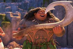 """This image released by Disney shows characters Maui, voiced by Dwayne Johnson, right, and Moana, voiced by Auli'i Cravalho, in a scene from the animated film, """"Moana.""""  (Disney via AP) ORG XMIT: NYET604"""