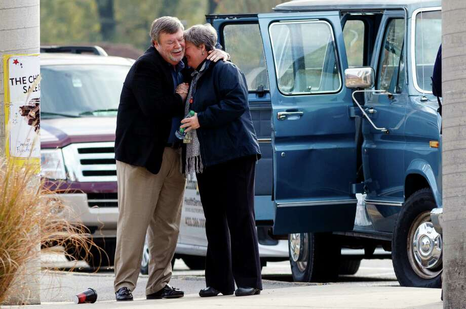 Volunteers in Chattanooga, Tenn., embrace Tuesday at Woodmore Elementary, the school of the bus crash victims. The driver, Johnthony Walker, 24, has been charged with vehicular homicide. Photo: Doug Strickland, MBI / Chattanooga Times Free Press