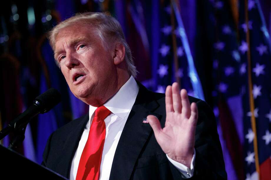 FILE - In this Nov. 9, 2016 file photo, President-elect Donald Trump speaks during an election night rally in New York. Trump's charity has admitted that it violated IRS regulations barring it from using its money or assets to benefit Trump, his family, his companies or substantial contributors to the foundation.  (AP Photo/ Evan Vucci, File) Photo: Evan Vucci, STF / Copyright 2016 The Associated Press. All rights reserved.