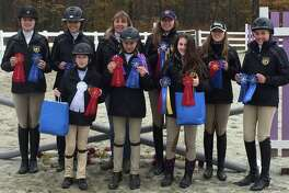 Cavalier Farm in New Milford has announced its middle and high school interscholastic equestrian teams each won champion at their first show of the season. The show was held Nov. 5 at ABF Equine in Coventry. They are, from left to right, in front, Reagan Rivera, Devon LeMoine and Madison Jennes and, in back, Annie Fournier, Alycia Petrauskas, coach Cheryl LeMoine, Chelsea LeMoine, Jordan Guilmart and Carolynn DeBellis.