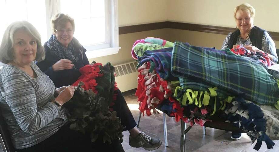 Members of the Woman's Club of Danbury and New Fairfield recently made 30 No-Sew Blankets to donate to Danbury Regional Hospice. This is the third year in which the Home Life Committee has volunteered time and materials in creating these much-needed items. In the spring, members will meet again to make many more warm blankets for Hospice. Above, label sewers are, from left to right, Geri Hopper of New Milford, Mary Schaughnessy of Brookfield and Ronnie Rawlings of New Fairfield. Photo: Courtesy Of Woman's Club Of Danbury And New Fairfield