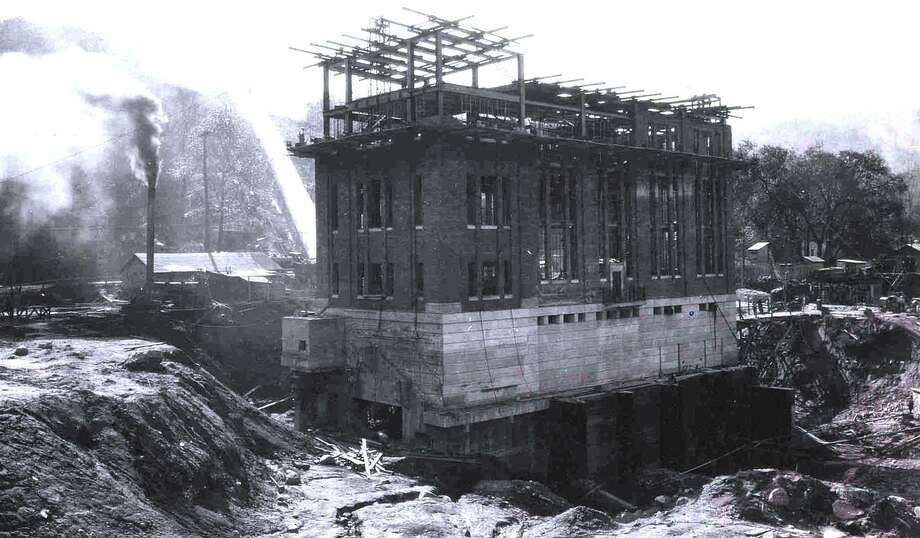 The construction of the Rocky River generating power station along the Housatonic River and Route 7, just north of the town center of New Milford is shown above on Oct. 5, 1927. This project was associated with the creation of Candlewood Lake. Photo: Contributed Photo / Contributed Photo / The News-Times Contributed