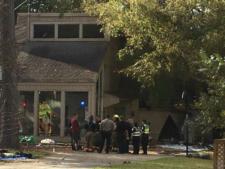 Improperly disposed fire pit ash ignited a two-story home in Willis Tuesday in the 15000 Block of Jamaica Circle, according to the Montgomery County Fire Marshal's Office. Photo: Meagan Ellsworth