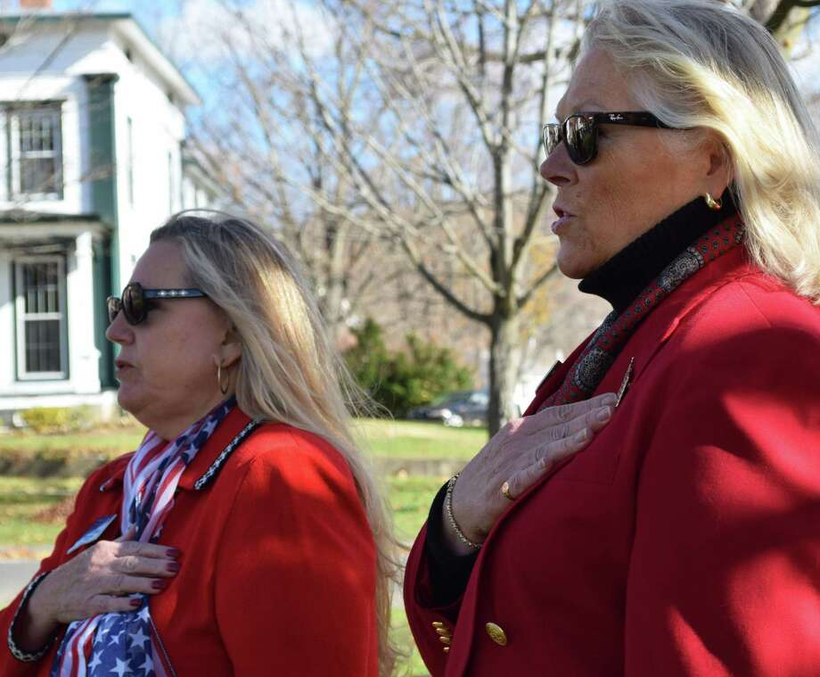 "Spectrum/Jennie Rehnberg, left, and Katy Francis of the Roger Sherman Chapter, Daughters of the American Revolution join others in the ""Pledge of Allegiance"" at the Veterans Day ceremony held Nov. 11, 2016, in New Milford. Photo: Deborah Rose / Hearst Connecticut Media / The News-Times  / Spectrum"