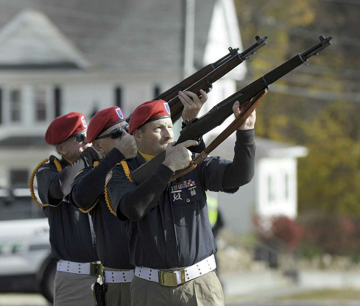 New Milford Veterans Honor Guard give a rifle salute during New Milford's annual Veterans Day ceremony on the New Milford Green, Friday, Nov. 11, 2016