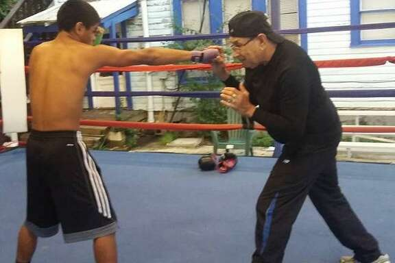 Charlie Mata trains Chris Churbee, 17, as part of the Boxing Advocates S.A. program in the Prospect Hill area of the city.