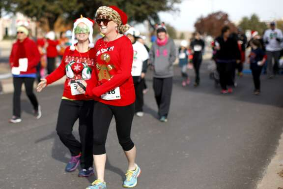 Runners taking part in a Jingle Bell Run.