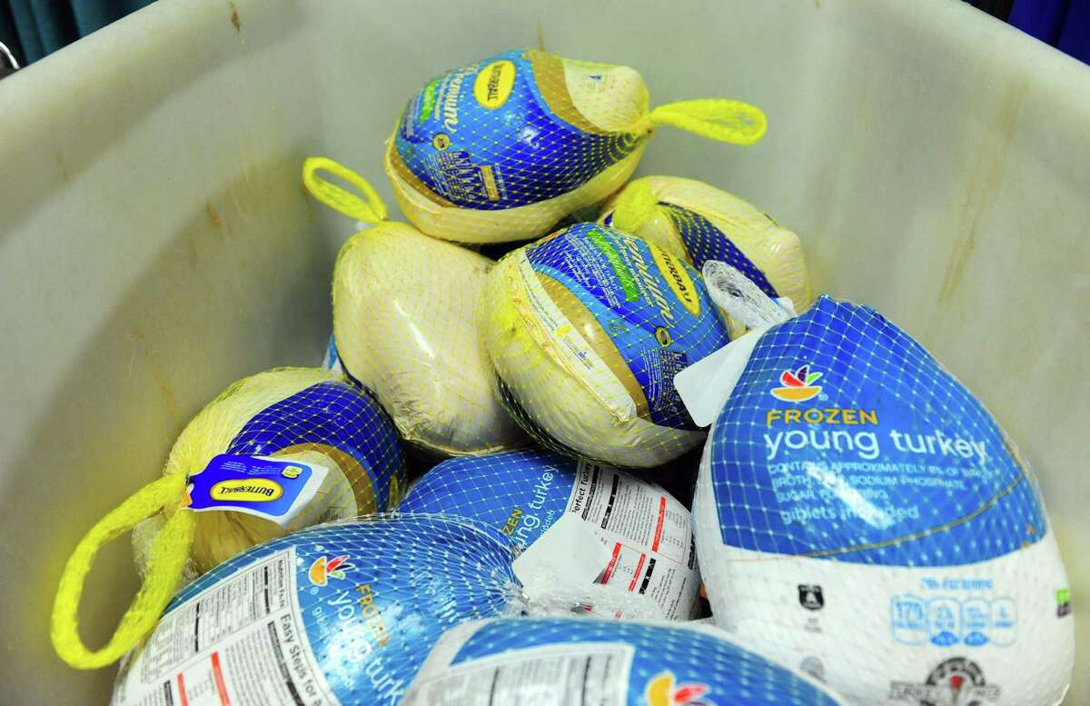 The 7th Annual Feed the People Food Pantry Thanksgiving Food Drive held at the Aquaculture School in Bridgeport, Conn. on Tuesday Nov. 22, 2015. The drive was held at the Aquaculture School for the first time so some of the students could volunteer and because the school donated some of the food. The Feed the People Food Pantry is located at the P.T. Barnum Apartments and accommodates food for over 500 families. Its founder, Prophetess Geraldine Claytor, passed away in 2015 and her daughter Bennyta Thompson took over organizing the event.