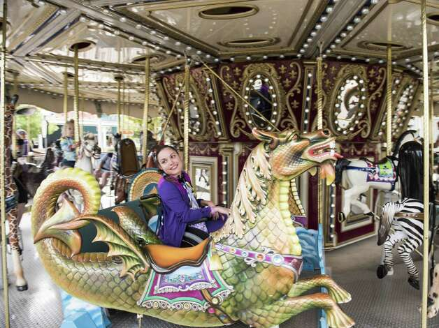 The 36-foot-in-diameter carousel at Morgan's Wonderland enables kids and adults of differing abilities to fully experience the fun of a merry-go-round. Specially designed 'chariots' enable guests in wheelchairs to go up and down and enjoy the ride just like everyone else. Photo: Carlos Sanchez /Contributor / San Antonio Express-News