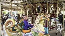 The 36-foot-in-diameter carousel at Morgan's Wonderland enables kids and adults of differing abilities to fully experience the fun of a merry-go-round. Specially designed 'chariots' enable guests in wheelchairs to go up and down and enjoy the ride just like everyone else.