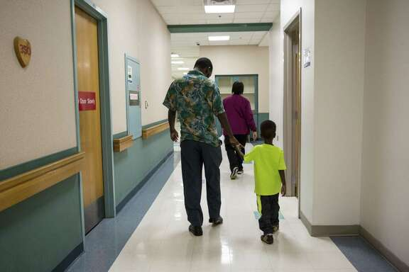 Bashir Maalim (left) holds Hamza Mohamud's hand during a follow-up appointment at University Hospital in San Antonio on Oct. 27. Hamza was born with a congenital heart defect; however, his family could not access the medical care and surgery he required in their home country of Kenya. Hamza was referred to HeartGift by a physician in Kenya. Dr. Adil Husain performed the procedure in San Antonio.