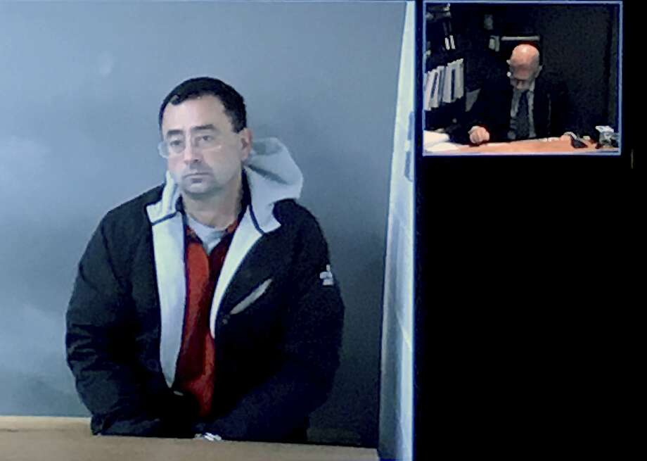 Former USA Gymnastics doctor Larry Nassar appears via video link for his arraignment hearing. Photo: Chris Haxel, Associated Press