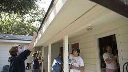 Volunteers from Spring Creek United Methodist Church  work inside and outside Magdalena House, a transitional home for women and children who have been abused on Saturday, November, 12, 2016.