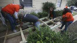 Volunteers from Home Depot install a ramp at the home of Sophia and Wayne Nunn near Boerne, Texas. The volunteers are taking part in the Texas Ramp Project led in San Antonio by area coodinator Larry Milton (not pictured).