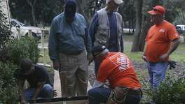 Volunteers from Home Depot install a ramp at the home of Sophia and Wayne Nunn near Boerne, Texas. The volunteers are taking part in the Texas Ramp Project led in San Antonio by area coodinator Larry Milton (second from right, wearing vest) and John Laine (center, wearing khaki pants) of Richardson, Texas.