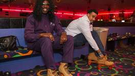 Vincent Matthews (left) dressed as Rick James and Stephen Spinks lace-up at a Halloween party for Pay It Forward, a drug and alcohol recovery program run through Haven for Hope, Oct. 27 at Car-Vel Skate Center.