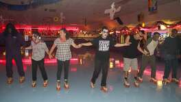 Nearly 60 people in the alcohol and drug recovery programs, Pay It Forward and Clean & Sober Living, which are run out of Haven for Hope, gather for a Halloween party at Car-Vel Skate Center Oct. 27.