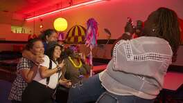 Nearly 60 people in the alcohol and drug recovery programs, Pay It Forward and Clean & Sober Living, which are run out of Haven for Hope, gather for a Halloween party at Car-Vel Skate Center.