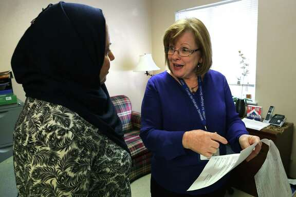 Margaret Constantino,  director of the Center for Refugee Services speaks with Samar Al-Ruznamachi of Iraq.