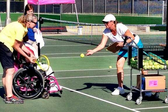 San Antonio Tennis Association board member Annette Armstrong (right) volunteers her time at an SAISD Special Olympics Skill Day at McFarlin Tennis Center in 2016.