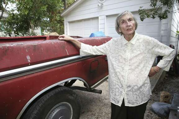 "Marie Stout shows off ""Big Red,"" her 1978 Ford pickup truck parked in her driveway on Nov. 1."