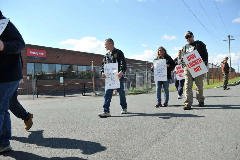 Honeywell workers picket outside the plant after the company locked out the workers early Monday morning, May 9, 2016, in Green Island, N.Y.   (Paul Buckowski / Times Union) Photo: PAUL BUCKOWSKI / 20036532A
